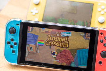 Bangkok,Thailand - May 30, 2020: Animal crossing popular Nintendo switch with joy controllers family friend activity.