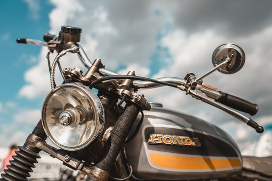 Minsk, Belarus - September 13, 2019: A vintage Honda motorcycle against a blue sky with clouds ready for a long trip