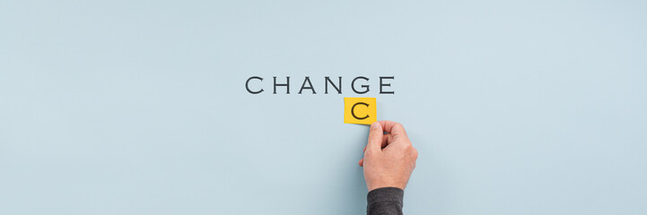 Male hand changing the word Change into Chance