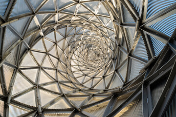 Geometric spiral architecture view from inside low-angle