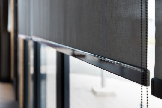 blind curtain or black blinds Roller sun protection in office.