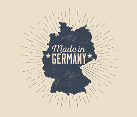 Made in Germany badge or label or tag design template with black silhouette of Germany map with sunburst isolated on light background. Vintage styled vector illustration