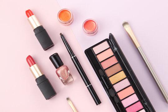 various cosmetics on geometric background
