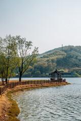 Geumgwang Lake and Korean traditional pavilion with mountain in Anseong, Korea