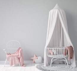 Interior mock up wall in newborn bedroom, empty gray background with rattan crib and chair, pink plaid and stuffed toys. Scandinavian baby room design