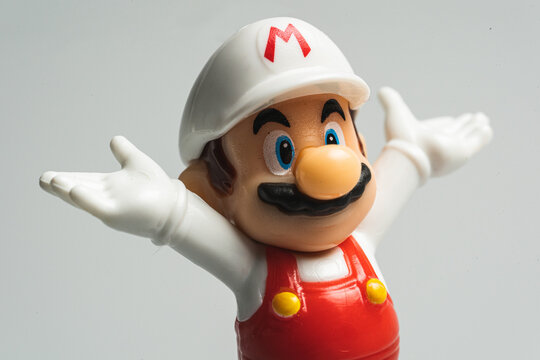 Macro shot of the famous video game star Character from Nintendo Super Mario bros white hat edition (Kinder surprise toy). Illustrative editorial.