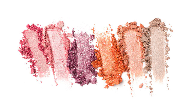 Close-up of make-up swatches. Smears of crushed shiny color eye shadow with brush
