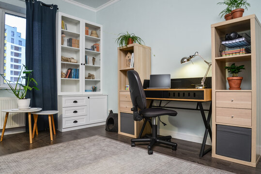 Light cozy teen room with white bookcases