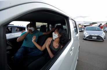 People wearing protective face masks attend the first drive-in concert, in Colombo