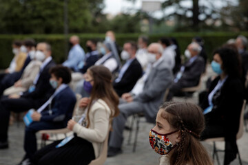 Faithful wearing face masks to prevent the spread of the coronavirus disease (COVID-19) pray during a rosary lead by Pope Francis in Vatican gardens