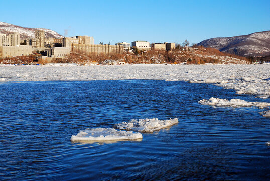 A small ice flow floats in the Hudson River in front of West Point