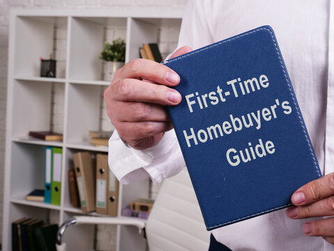 First-Time Homebuyer's Guide is shown on the conceptual business photo