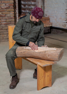 craftsman sanding a piece of wood in the workshop
