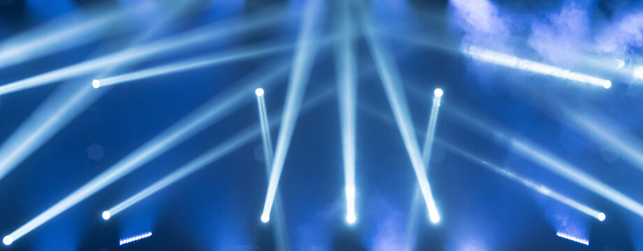 Concert live streams available online. Show must go on. Stage for musicians. Online event. Empty stage with blue spotlights. Blue stage lights.