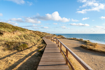 Wall Mural - Wooden pier along the beach on the island of Sylt, Schleswig-Holstein, Germany