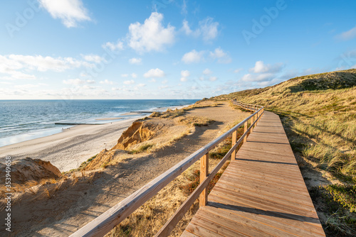 Wall mural Walking along the Rotes Kliff on the island of Sylt, Schleswig-Holstein, Germany