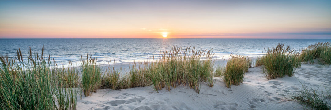 Dune beach panorama at sunset