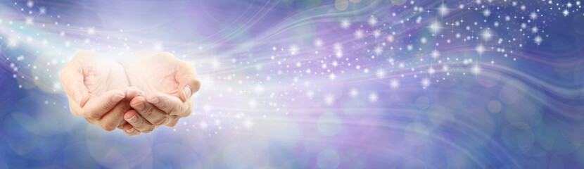 High Resonance Healing Energy Message Background - female cupped hands beside a flow of sparkles against a lilac blue energy field background with copy space
