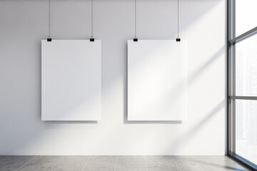 Two mock up poster in white wall room