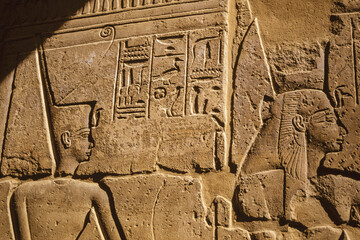 Wall with hieroglyphs in a temple of Egypt