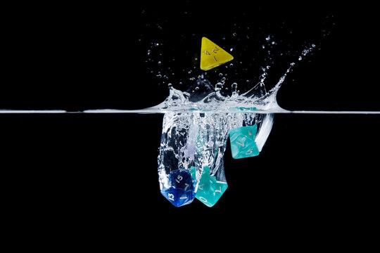 Dice splashing in water
