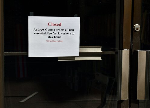 """Sign on a glass door reading """"Closed Andrew Cuomo orders all non-essential workers to stay home till further notice"""", May 30, 2020, in New York."""