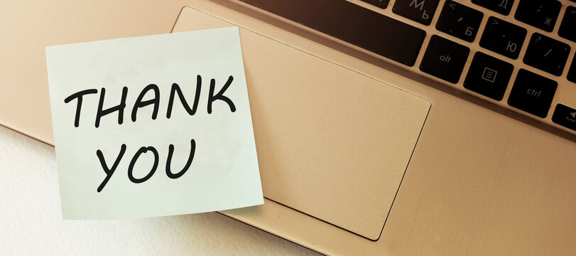 THANK YOU guidelines blank paper out of a laptop screen, isolated on white background recruiter