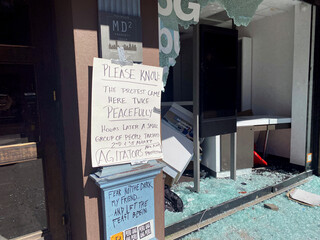 Business store windows are seen smashed along 2nd Avenue after protests the night before, during nationwide unrest following the death in Minneapolis police custody of George Floyd, in the East Village neighbourhood of Manhattan