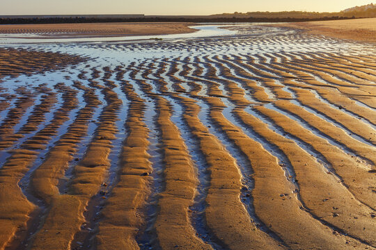 Sand waves, textures and shapes that occur at low tide