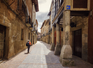 Pilgrim delights when he enters the streets of Los Arcos, a town in Navarra on  the Way of St. James, Spain