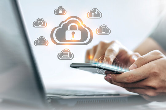 Young Asian man is holding a smartphone, Personal data Security lock cyber is a key safe device protection upload backup data on the cloud keep for privacy database. Concept of preventing data theft