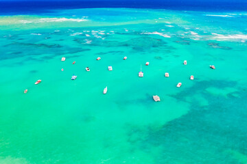 Wall Murals Green coral Aerial view of tropical caribbean sea with yachts and boats on blue turquoise ocean. Dominican Republic
