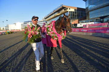 Trainer Daniel Reden celebrates as he walks with horse Propulsion after the final of Elitloppet trotting event at Solvalla track without an audience due to the coronavirus disease (COVID-19) outbreak, in Stockholm