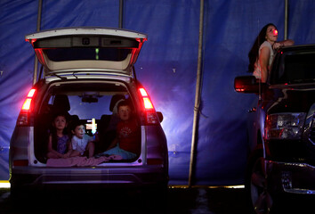 People watch a circus performance in Atayde's Circus tent, where people enjoy the show from their cars as a measure to combat the spread of the coronavirus disease (COVID-19), in San Nicolas de los Garza