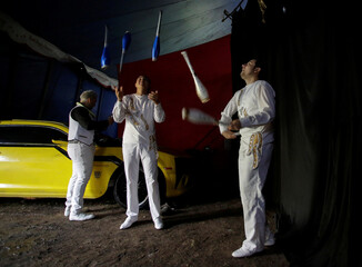 Jugglers practice before presenting their act during a circus performance in Atayde's Circus tent, where people enjoy the show from their cars as a measure to combat the spread of the coronavirus disease (COVID-19), in San Nicolas de los Garza