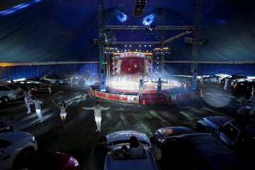 Artists thank the audience during a circus performance in Atayde's Circus tent, where people enjoy the show from their cars as a measure to combat the spread of the coronavirus disease (COVID-19), in San Nicolas de los Garza