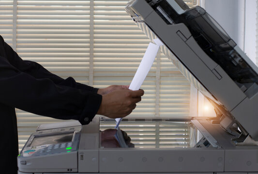 Man copying paper from the Photocopier, Man use copier machines.
