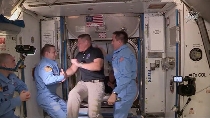 NASA astronaut Bob Behnken and Doug Hurley arrive at the International Space Station aboard SpaceX's Crew Dragon capsule in this still image taken from video