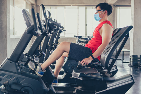 Sport man wear face mask for work out at fitness gym. Social distancing and wellness. Fit and firm for healthy. Mind-body improvements. New normal and life after COVID-19.