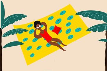 Woman lying on a towel
