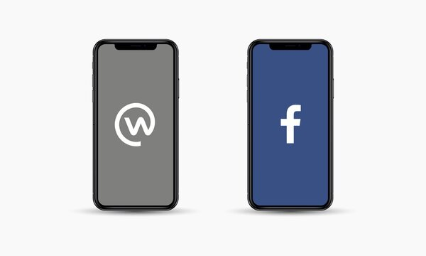 Apple Iphone with different social media logos: Workplace and Facebook