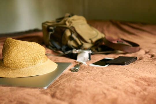 Concept travel prop with a hat and bag and laptop