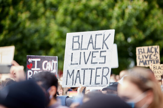 """Sign """"BLACK LIVES MATTER"""" amongst others at the Police Violence march for George Floyd"""