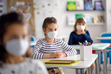 Fototapeta Children with face mask back at school after covid-19 quarantine and lockdown. obraz
