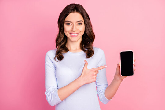 Photo of beautiful lady hold telephone hands directing finger touch screen advising amazing renew interface model sale manager wear casual white shirt isolated pastel pink color background