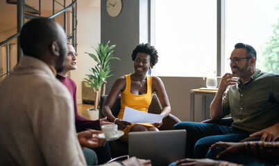 Group of diverse businesspeople smiling during a casual meeting