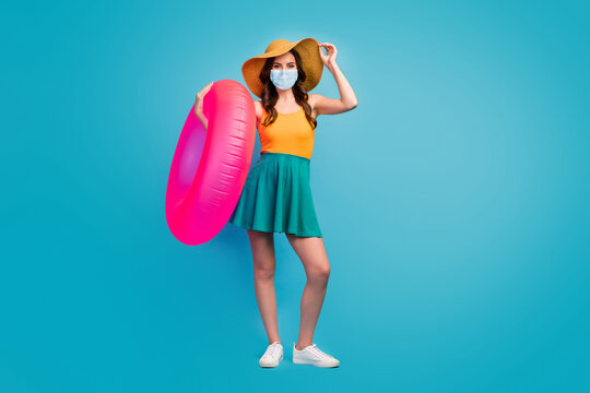 Full length body size view of her she pretty lady hold pink rubber ring wear mask public place social distance visit poolside isolated over bright vivid shine vibrant blue color background