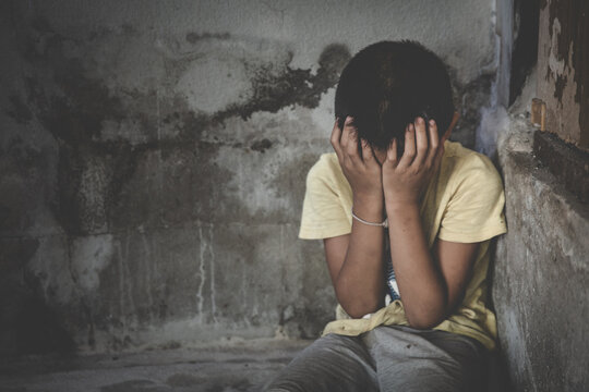 Depressed child, domestic violence. stop abusing violence,  human trafficking, stop violence against child, Stop child abuse, Child labor, Human rights violations.