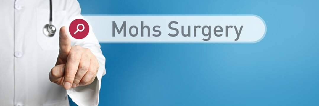 Mohs Surgery. Doctor in smock points with his finger to a search box. The term Mohs Surgery is in focus. Symbol for illness, health, medicine