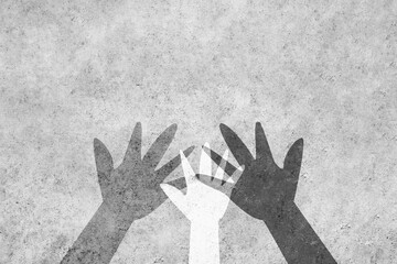Hands of different colors unite against racism. Design with a powerful concept against racism with copy space.